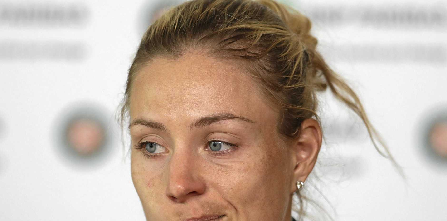 World No.1 Angelique Kerber shows her disappointment after losing to Russian Ekaterina Makarova in the first round of the French Open tennis tournament.