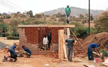 Raleigh volunteers build the new toilet block in Endagikot in Tanzania.