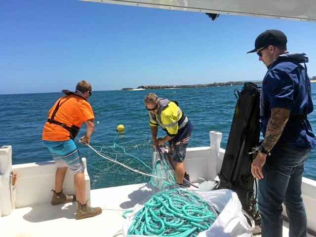 DPI staff installing the nets during the last trial.