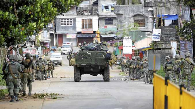 Philippine marines walk to the frontline in their continuing assault to retake control of some areas of Marawi city.