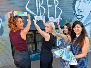 UNITY: Uber Hair's Kerri-Anne Rowlands, Nicola Peel and Ainsleigh Fieldus with WIN's Elmira Esfahani and some of the brick designs.