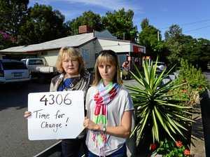 FED UP: Wendy de Graaf (left) and Simone Karandrews of Karana Downs would like to see a new postcode created instead of 4306.