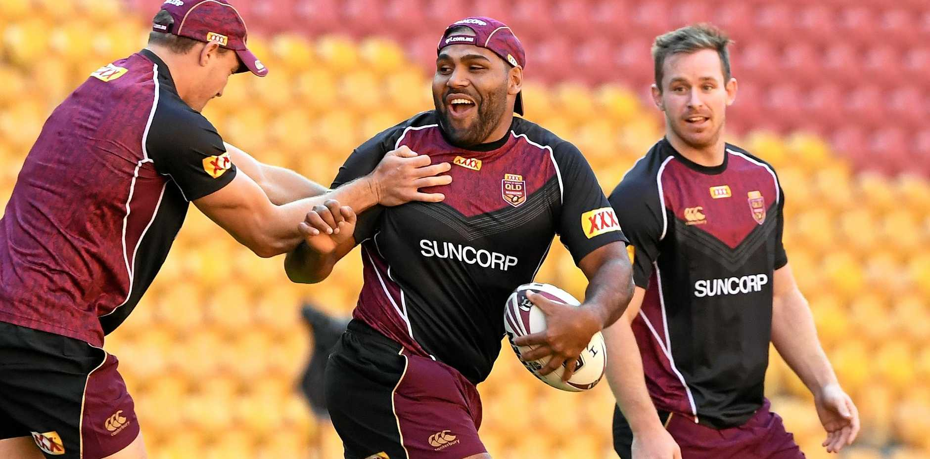 GAME ON: Sam Thaiday (centre) runs the ball during a Queensland State of Origin team training session.