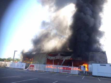 The building is fully engulfed in flames.
