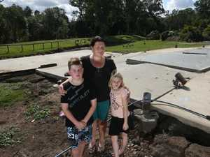 Defying Debbie: Mum stays positive despite home floating away