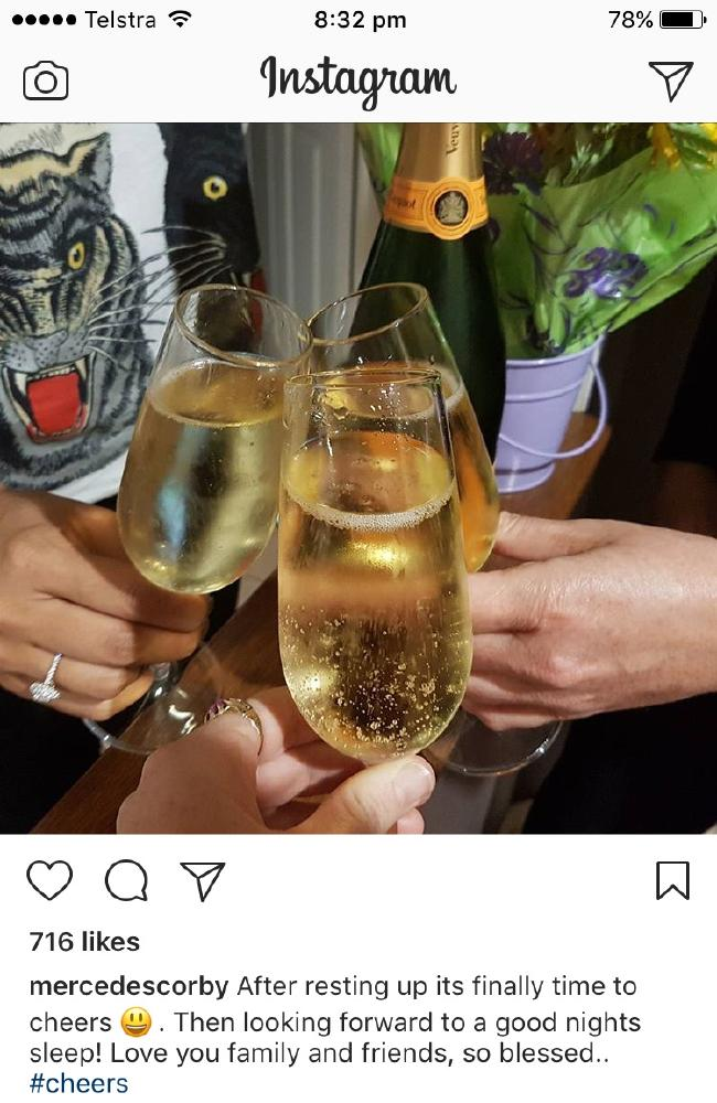 Mercedes Corby celebrates with champagne.
