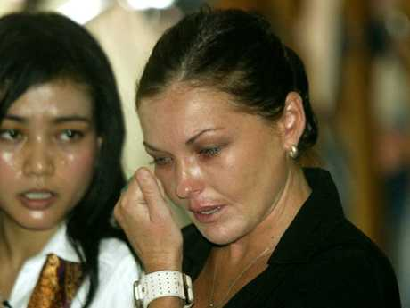 Schapelle Corby cries in court with her translator Eka after being found guilty of smuggling marijuana into Bali, Indonesia, and sentenced to 20 years in prison on May 27, 2005.