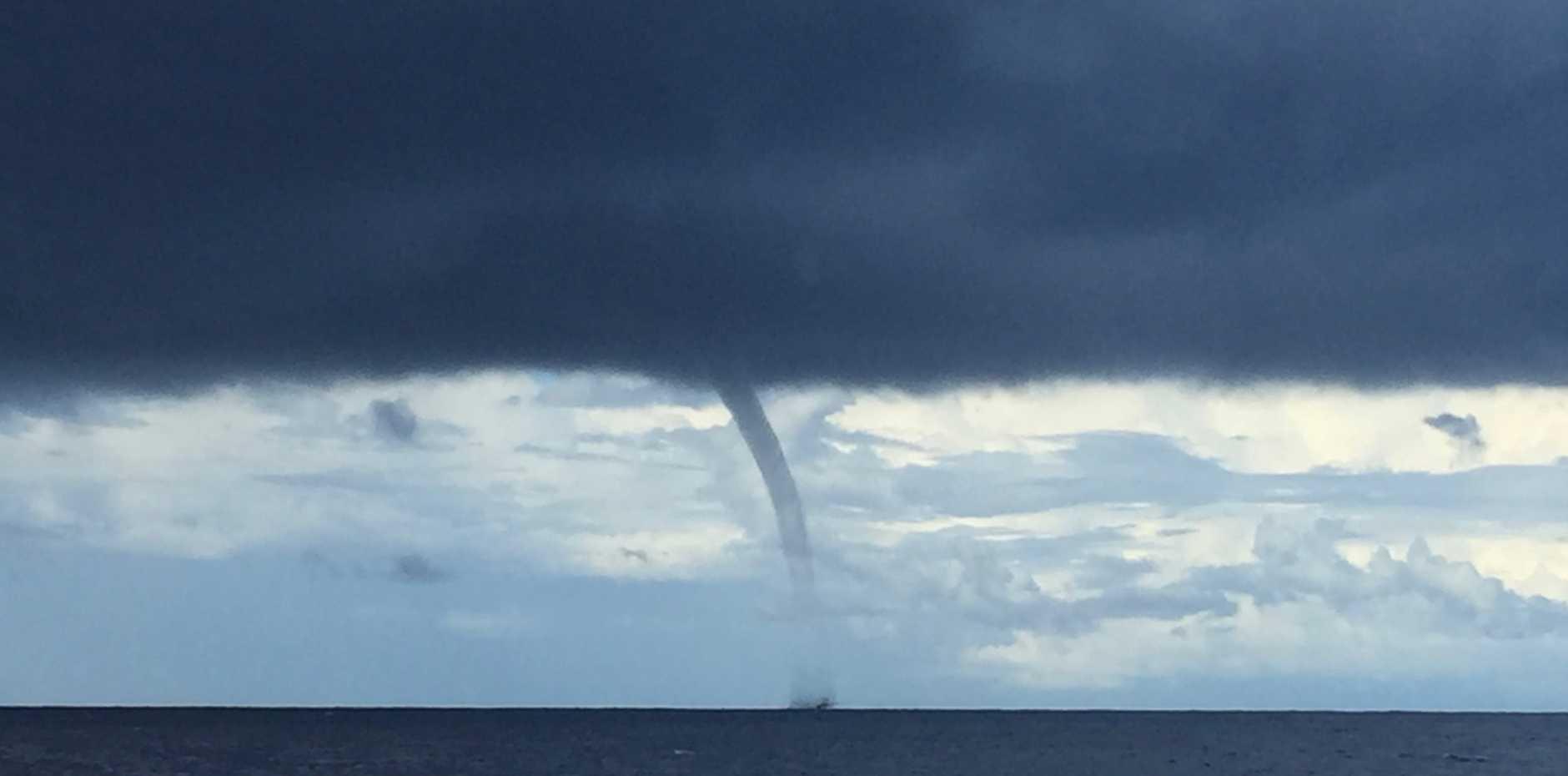 A tornado off the Sunshine Coast appears to engulf a fishing trawler.