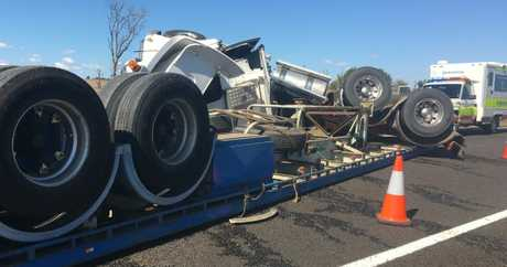 The overturned truck blocked the highway after it rolled near Miles at the weekend.