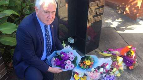 Toowoomba mayor Paul Antonio lays flowers in honour of fallen police officer Brett Forte.