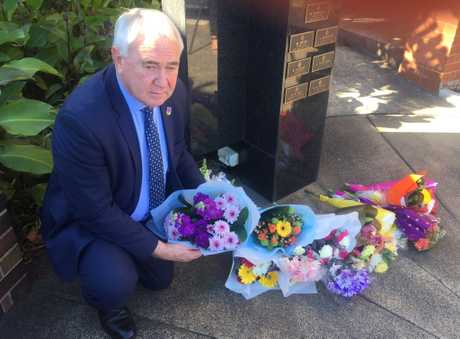 Toowoomba mayor Paul Antonio lays flowers in honour of fallen police officer Brett Forte.