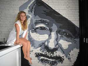 TALENT: Liz Ottey with her mural at Hemmingway's.