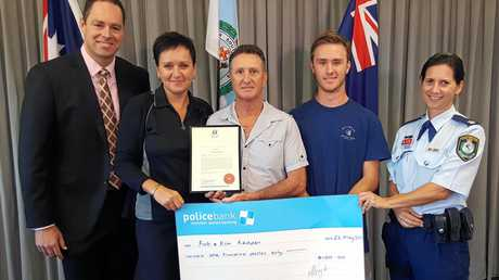 The Redden Family receives a Police Award for Community Service for assisting the family of missing swimmer Ali Mosawi. Pictured are Detective Sergeant Matt Zimmer, Kim, Rob & son Bray Redden and Chief Inspector Sharri Allison.