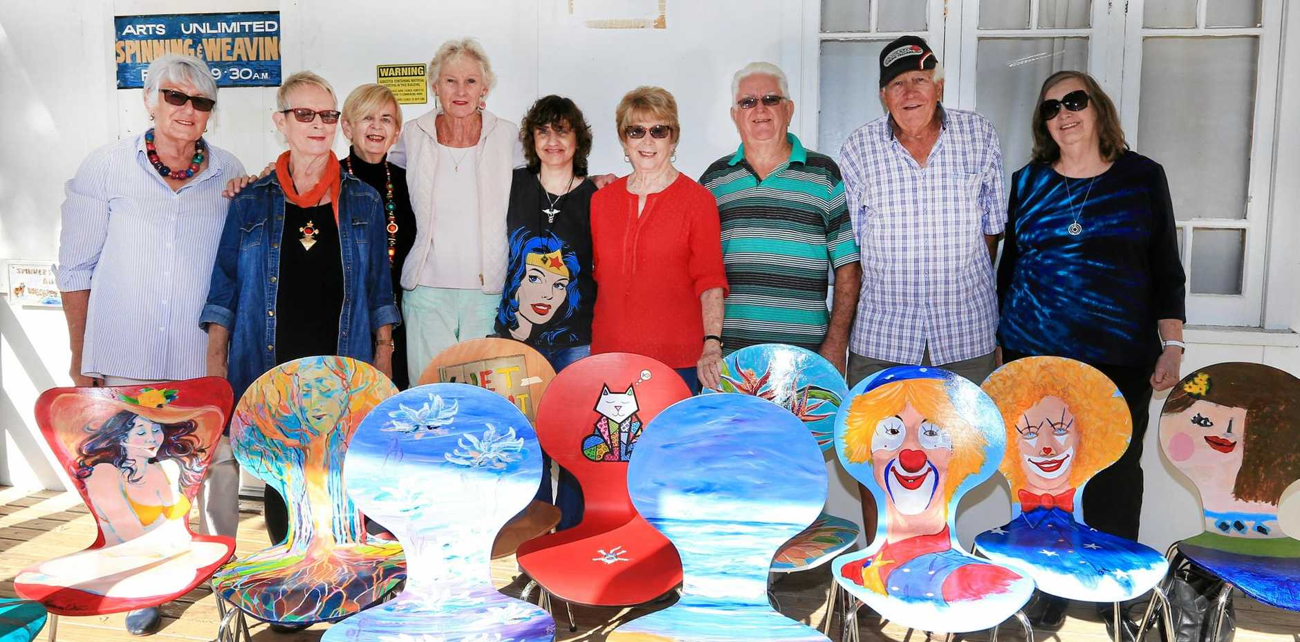 TAKE A SEAT: The Tweed Unlimited Arts members from Pioneer Parade, Banora Point. From left: Lyn McGrath, Rosemary Upton, Joanne Cutler, Marilyn Scotts, Jo Buckley, Bev McNamarra, Robert Stephen, Bruce Moore and Bev Hutchinson.