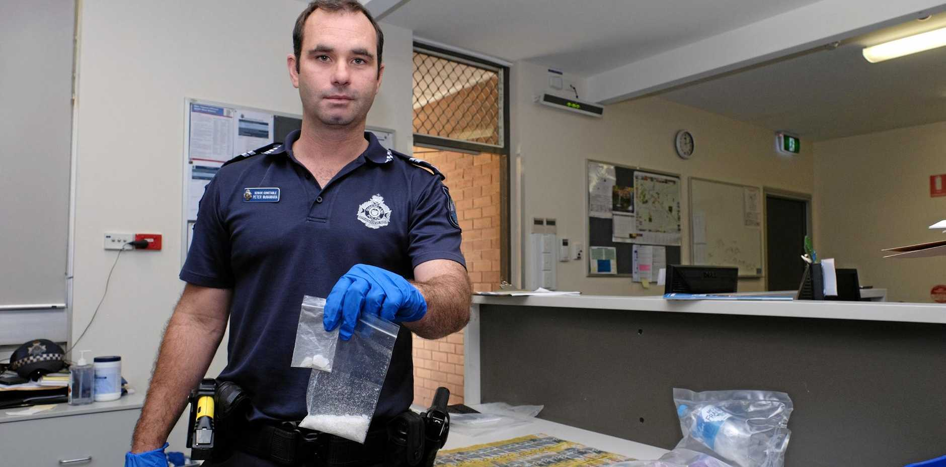 DRUG ISSUE: Senior Constable Peter McNamara with 17 grams of ice, seized in a raid in Chinchilla last year.