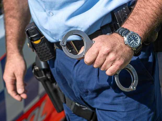 Hepatitis C positive Rockhampton man Michael Jason Lawrence was jailed for spitting on a police officer.