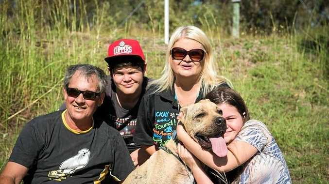 Team RSPCA Gladstone foster carer Sue-Ellen Thompson with Simba and his new family.