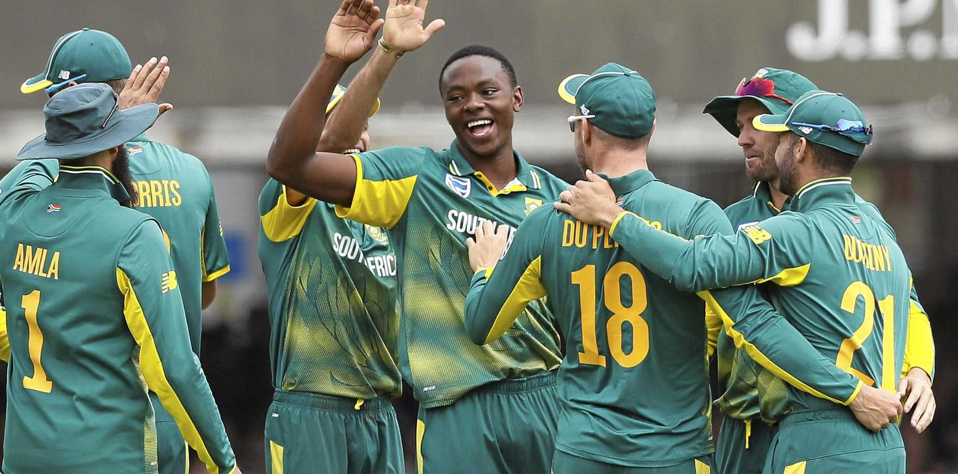 Kagiso Rabada, centre, celebrates taking the wicket of England's Adil Rashid during the third One Day International at Lord's.