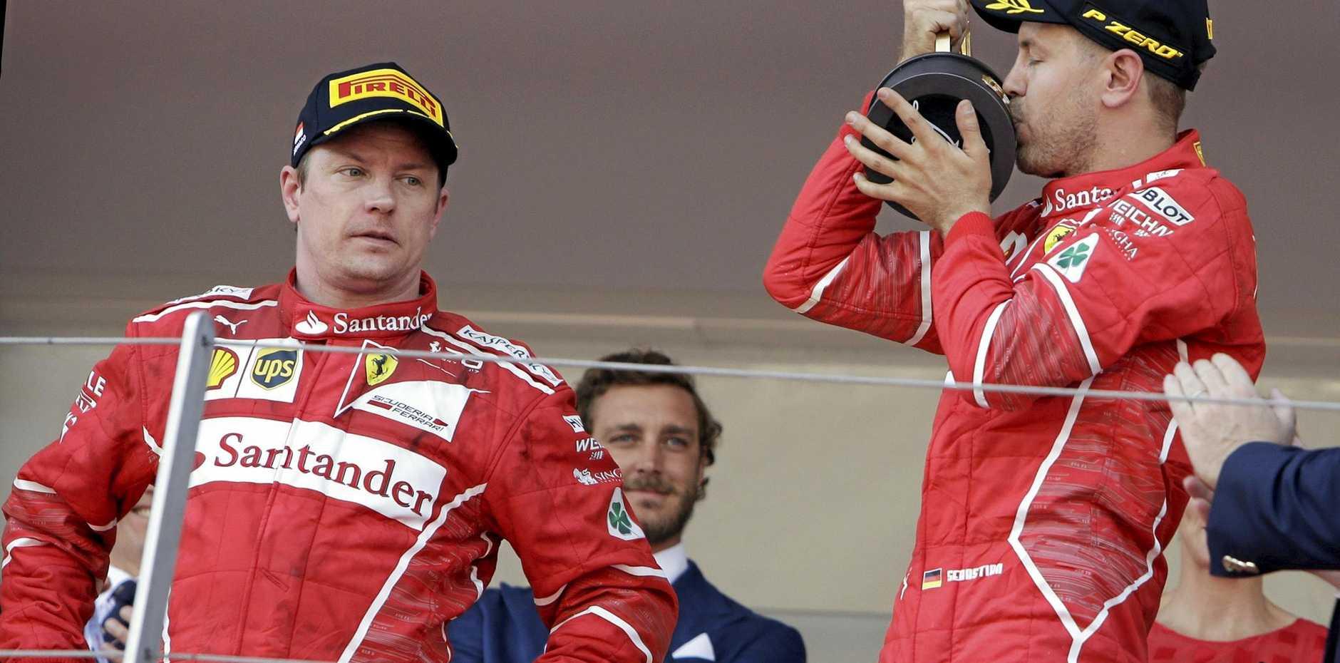 Ferrari driver Sebastian Vettel (left) of Germany celebrates beside his second-placed teammate Kimi Raikkonen of Finland at the Monaco Grand Prix.