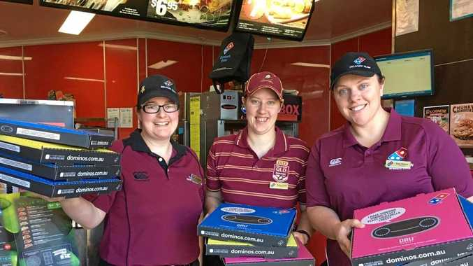 BUSY NIGHT: Dominos staff (from left) Katrina Copson, Robyn Love and Deb Ramm prepare for the State of Origin rush.