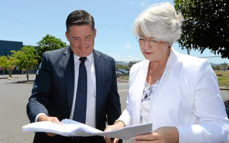 Aldi Property Director Brendan Geary with Mayor Margaret Stelow look over plans for the ALDI store which is to be built next to Fantastic Furniture on Gladstone Road.