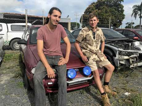 Kevin Kaya and Joshua Belford-Bartho with the newly purchased car.