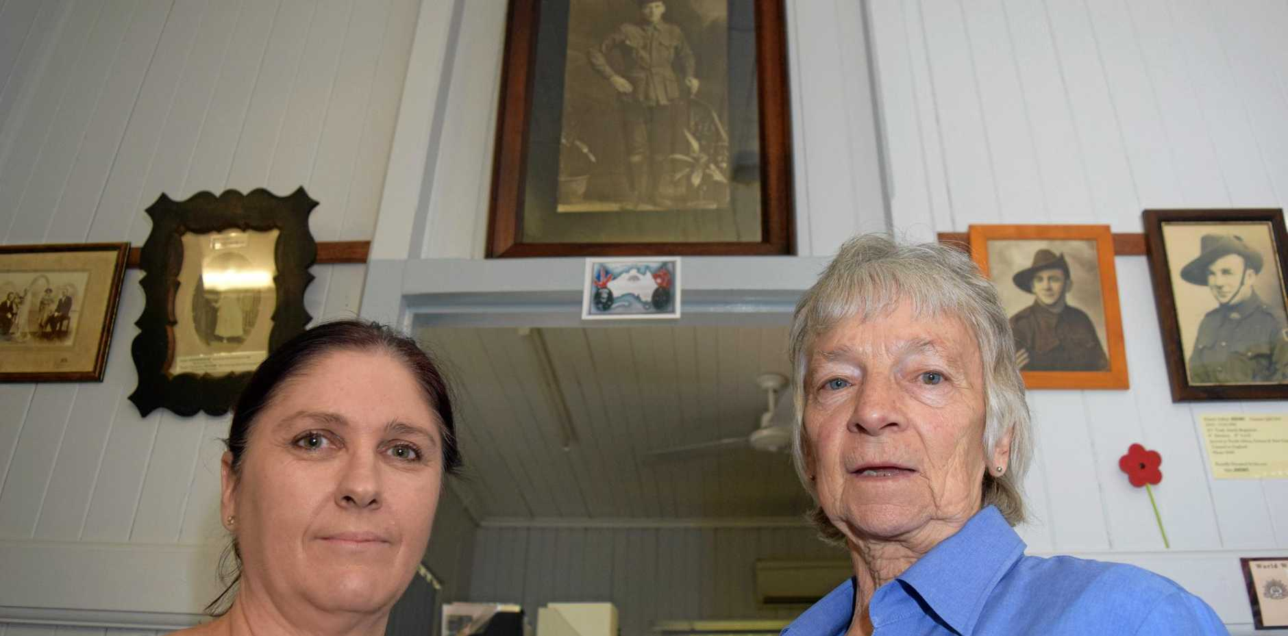 RIDDLE SOLVED: Relative of John Cowper, Betty McDonald, with Ipswich Genealogical Society president Irma Deas and (behind) the portrait of Private John Cowper.