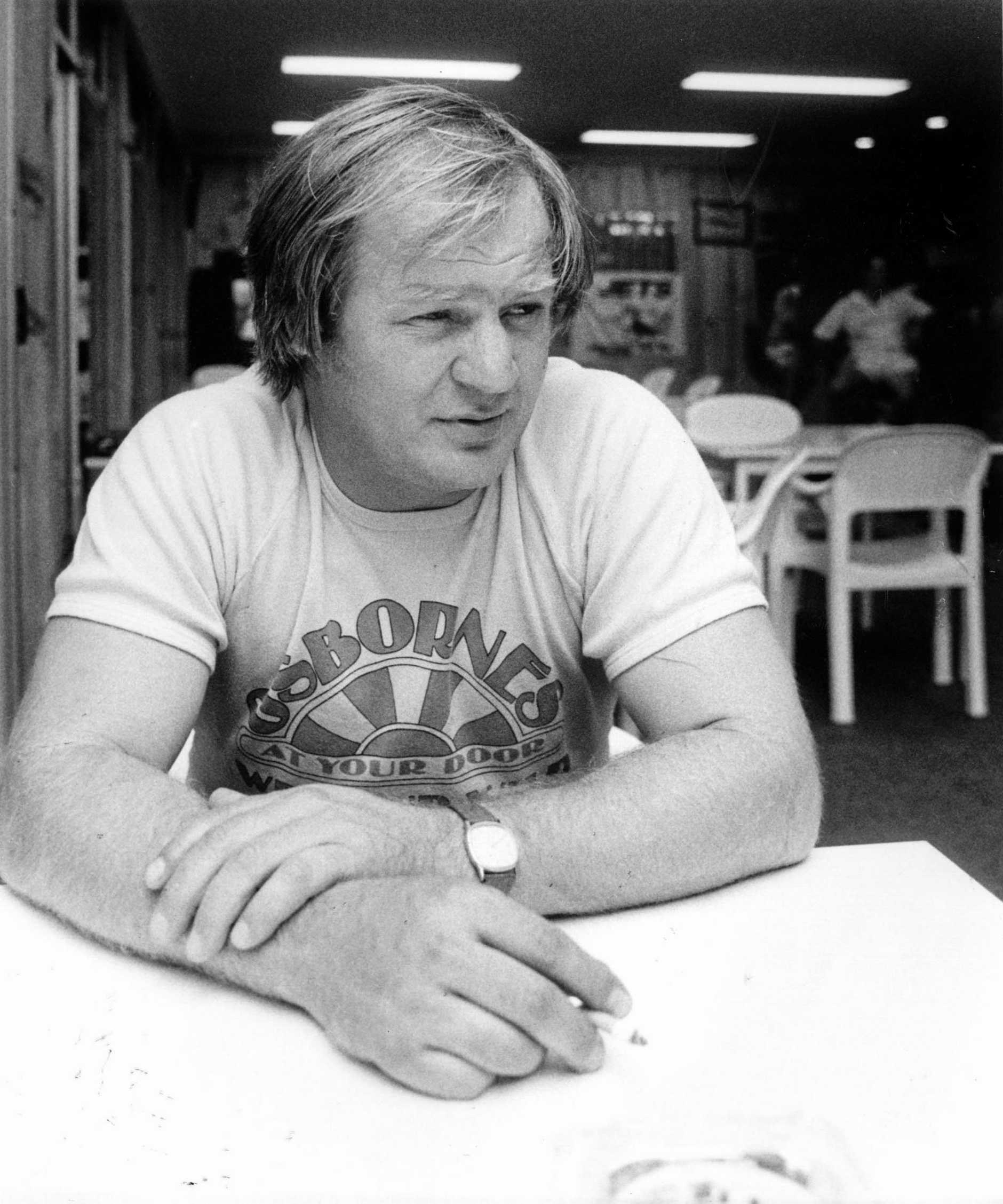 WILD MAN: Tommy Raudonikis has a quiet dart as he thinks about his next dressing room motivational technique as Ipswich Jets coach in the 1980s.