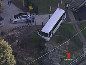 Busload of children left teetering over cliff