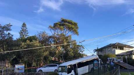 A bus believed to be full of kids on the edge of a cliff at Freshwater.