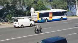 A man rides down Coronation Drive in Brisbane on his mobility scooter.
