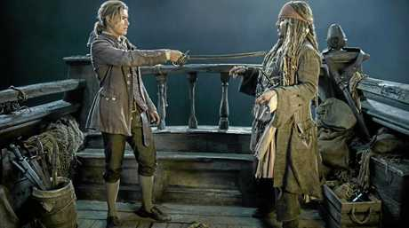 Brenton Thwaites and Johnny Depp in a scene from the movie Pirates of the Caribbean: Dead Men Tell No Tales.