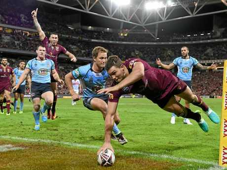 Corey Oates scores during the second State of Origin at Suncorp Stadium last year.