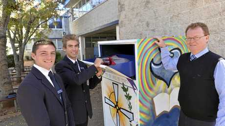 GOOD DEED: St Mary's College students Heath Dean (left) and Kyle Betros and principal Michael Newman with a brightly painted Vinnies donation bin, which is part of a new initiative with many schools in Toowoomba.