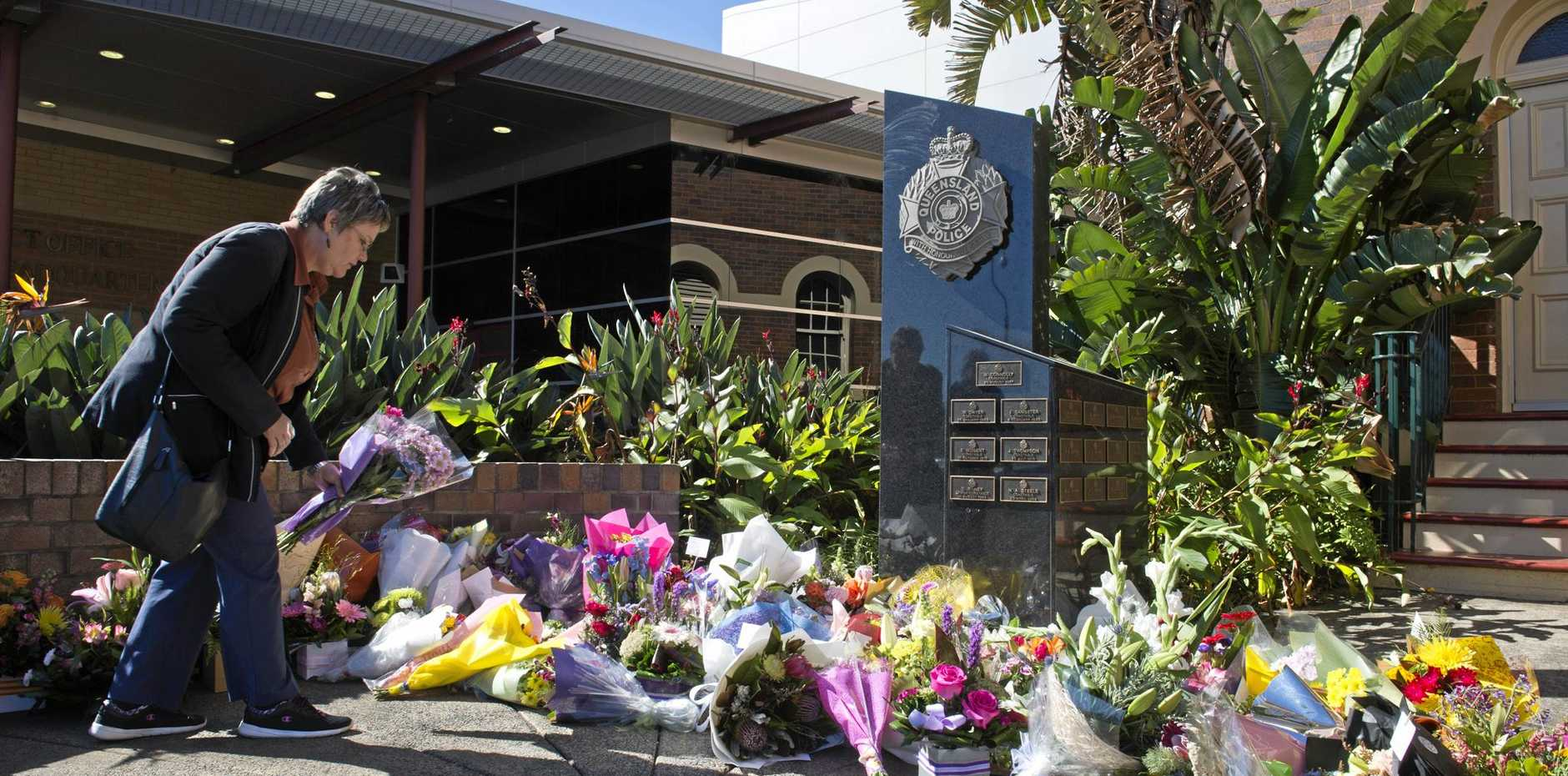 GROUNDSWELL OF SUPPORT: Flowers in tribute to Senior Constable Brett Forte left under the Toowoomba police memorial outside Southern Region District headquarters in Neil St yesterday.