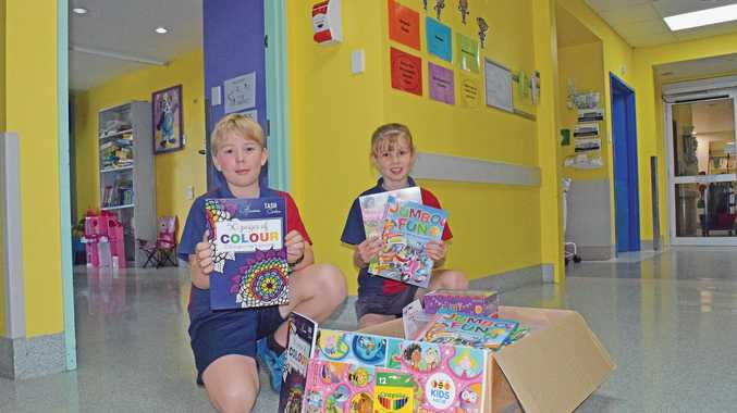 Arlia Akers and Jarrah Robert with the donation of colouring books, pencils and rubbers for the Hervey Bay Hospital Children's Ward.