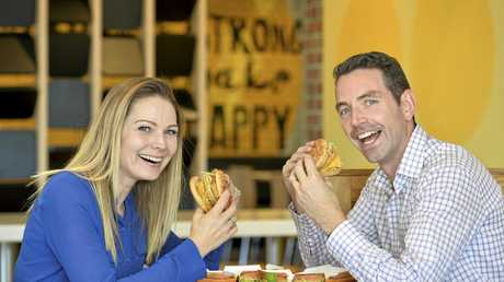 THEY'RE LOVIN IT: Customers Sunny Wood and Conor Ward try McDonald's new Chicken Big Mac at the Herries St store.