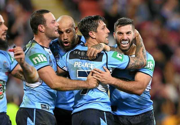 Mitchell Pearce celebrates with NSW Blues teammates at Suncorp Stadium.