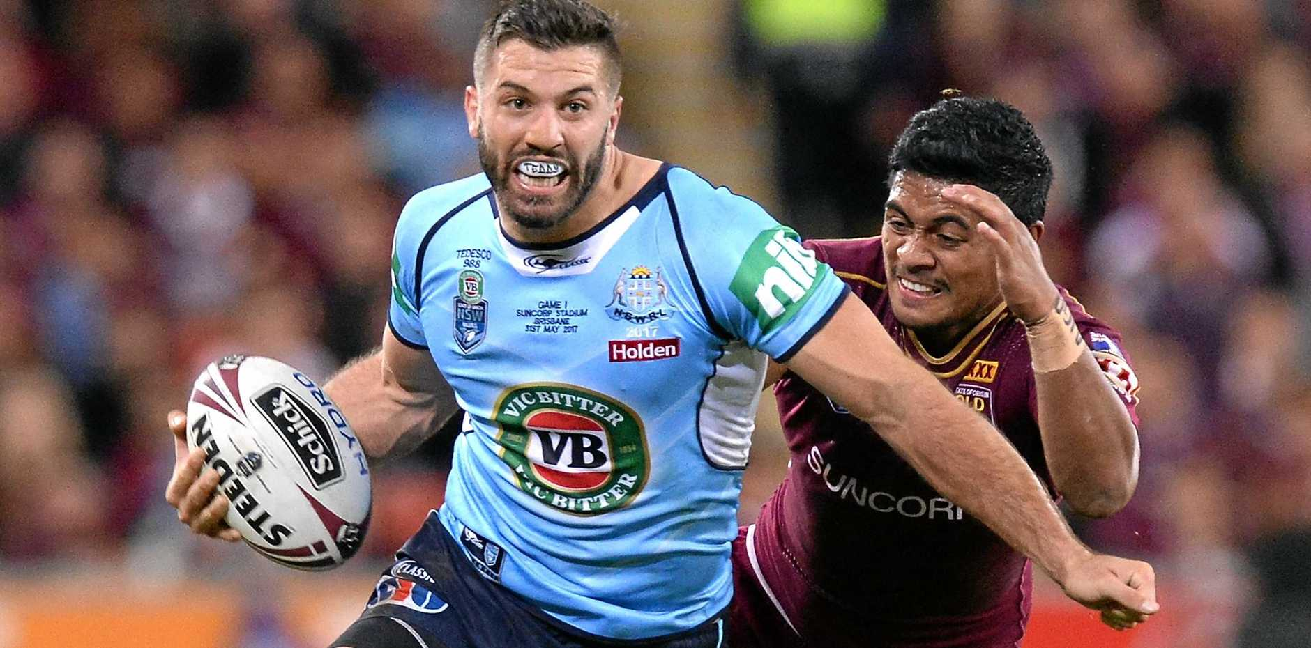 ALL-ROUND BRILLIANCE: NSW fullback James Tedesco slips through the Queensland defence.