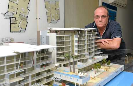 David Caracciolo with a model of the The Pier development, which has been put on hold indefinitely.