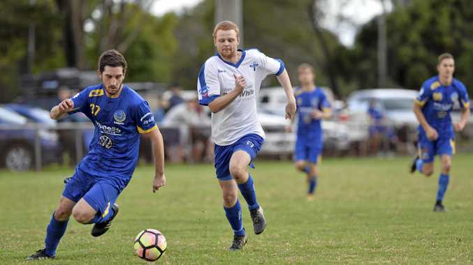CUP CLASH: Andrew Crestani of USQ and Aaron Chalmers of Rockville race to gain possession in round 11 of the Toowoomba Football League Premier at Toara Park.
