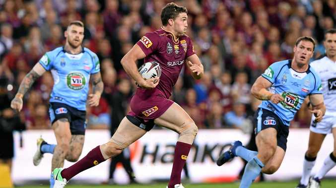 Queensland winger Corey Oates makes a charging run in the State of Origin opener on Wednesday night.