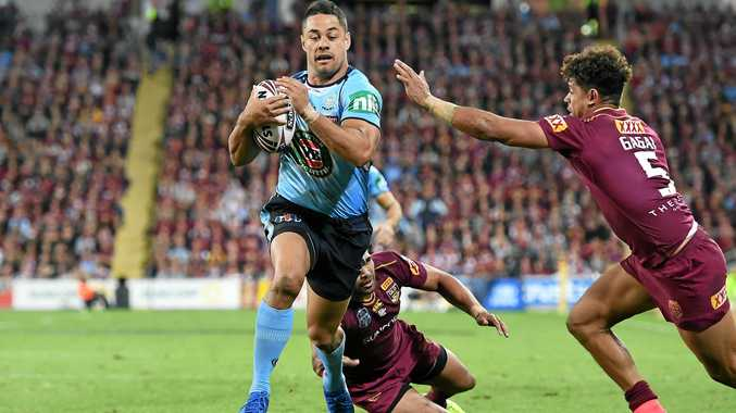 Jarryd Hayne of the NSW Blues runs to score a try.