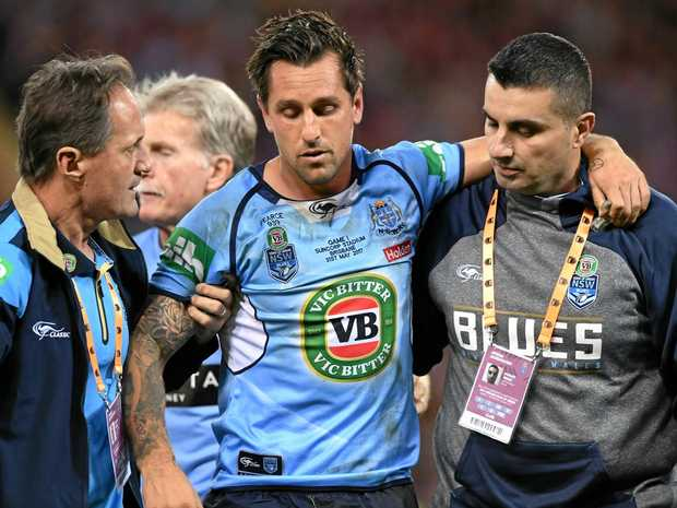 Injured NSW halfback Mitchell Pearce is taken from the field.