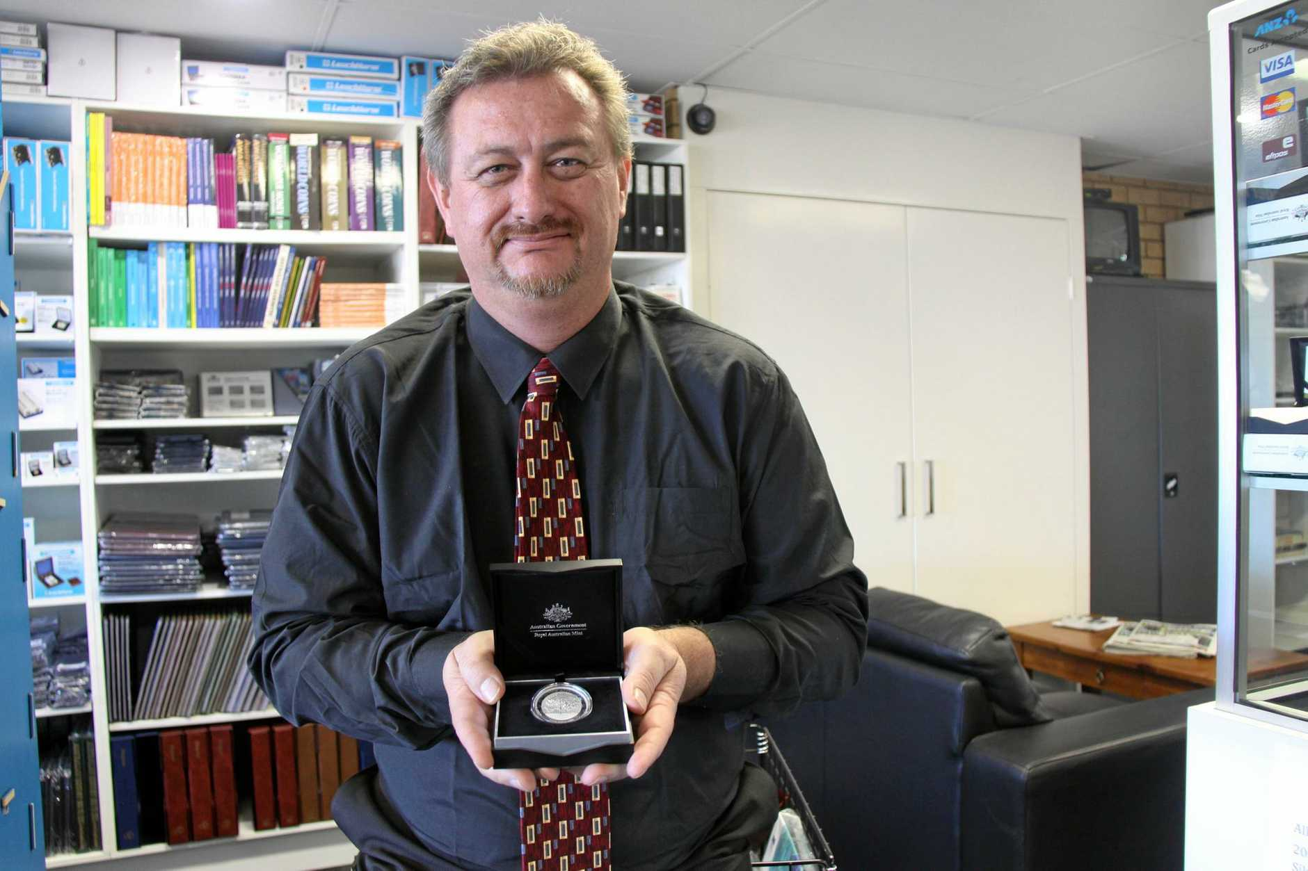 GAME ON: Andrew Mitchel of Online Coins & Collectables is auctioning off a limited edition 2015 $5 Centenary of the Gallipoli Landing Silver Proof Coin used at the coin toss at the 2015 PM's XI vs England XI at Manuka Oval, Canberra January 14, 2015, to raise funds fore Lifeline.
