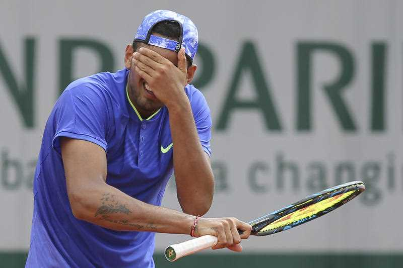 Australia's Nick Kyrgios gestures after missing a shot against South Africa's Kevin Anderson during their second round match of the French Open tennis tournament