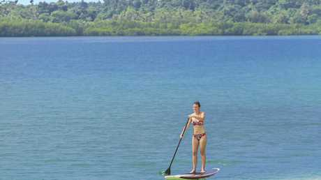 A visitor takes part in some stand-up paddleboarding on Erakor Lagoon; middle, Ramada Resort Port Vila; and right, the stunning scenery during the Off-Road Buggy Adventure in Port Vila.