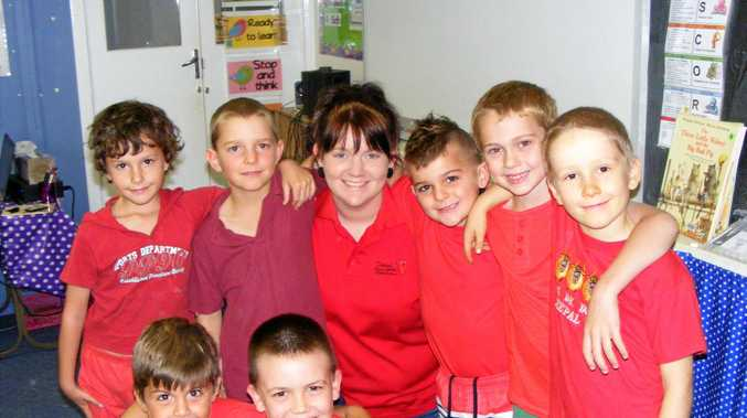 Ten years after leaving Chelona State School, Amy Privileggio (back, third from left) returned as a teacher.