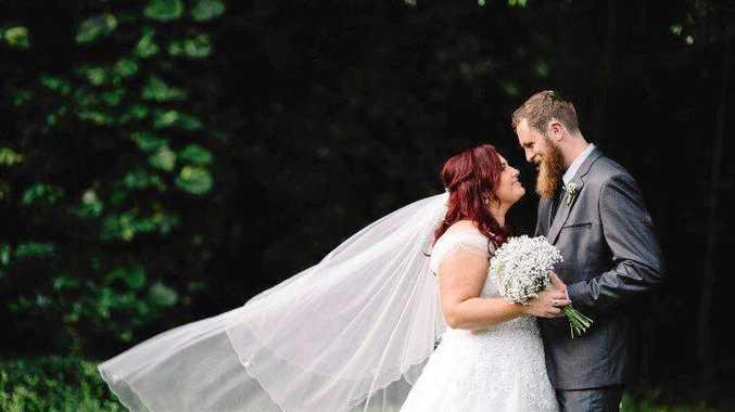 LOVED UP: Newlyweds, Amy and Sam Turner. Photo: Jocelyn Mackenzie Photography