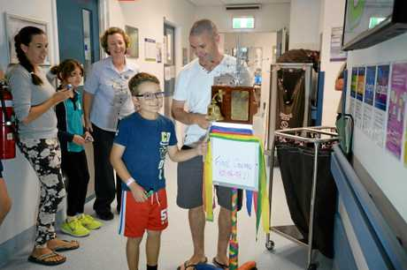 Anthony and Anthony Kiely ring the chemo bell.